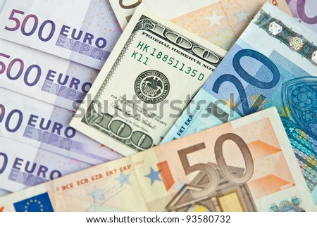 Closeup of different euro and dollars banknotes - stock photo