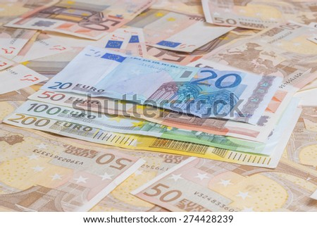 Closeup of different value euro banknotes background - stock photo