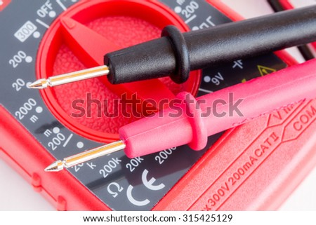 Closeup of digital multimeter  with two probes connected - stock photo