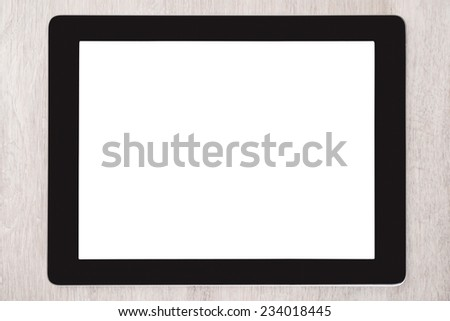 Closeup of digital tablet with blank white screen on wooden table - stock photo