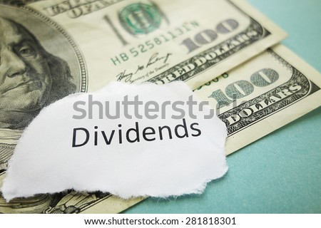 Closeup of Dividends message on cash - stock market concept