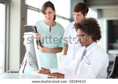 closeup of doctor and nurses in a meeting - stock photo