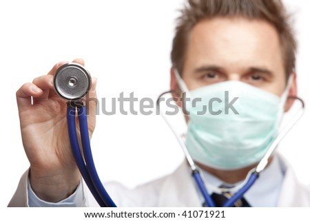 Closeup of doctor holding stethoscope into camera. Focus on stethoscope. Isolated on white. - stock photo
