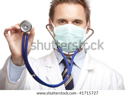 Closeup of doctor holding stethoscope into camera. Isolated on white. - stock photo