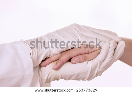 closeup of doctor's hands comforting patient isolated on white - stock photo