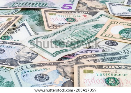 Closeup of dollar banknotes forming a money background