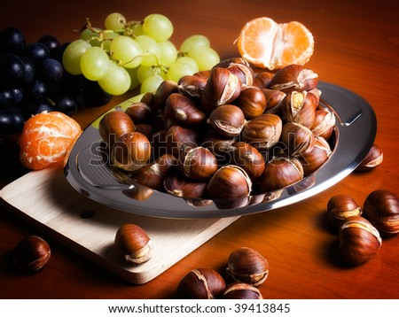 Closeup of domestic table after the autumnal harvest. - stock photo
