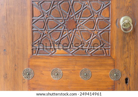 Closeup of door and carved wood panel in Istanbul - stock photo