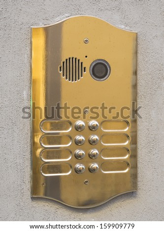 closeup of door intercom with camera, microphone and name identification - stock photo