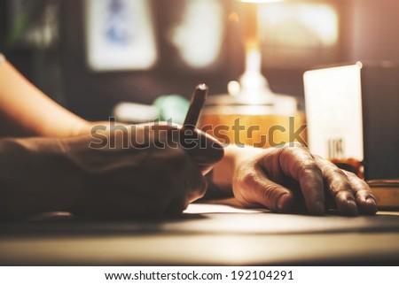 Closeup of drawing hands - stock photo