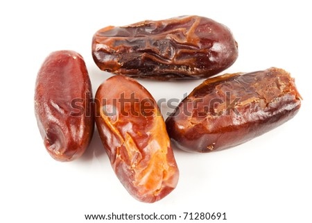 Closeup of dried dates, isolated on white background