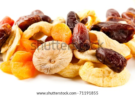 Closeup of dried fruits mix isolated on white background - stock photo