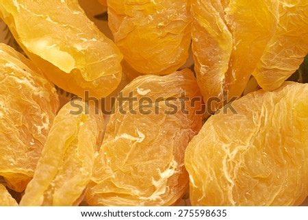 Closeup of dried golden peaches. - stock photo