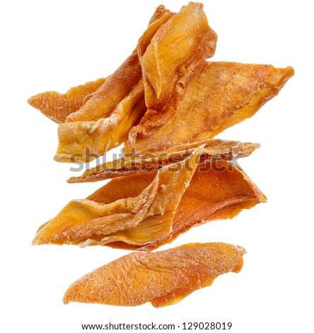 closeup of dried mango fruit slices, isolated on a white background - stock photo