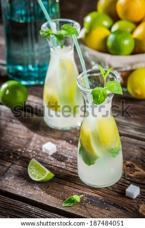 Closeup of drink with citrus fruit and ice - stock photo