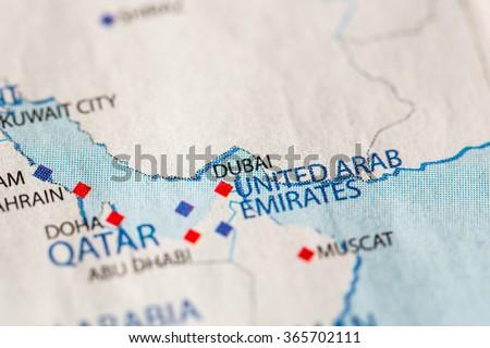 Closeup of Dubai, United Arab Emirates on a political map of Middle East. - stock photo