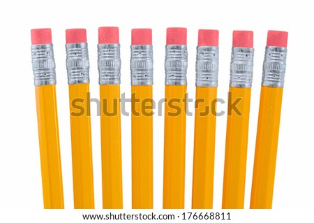 Closeup of Eight New Yellow Pencils with Erasers - stock photo