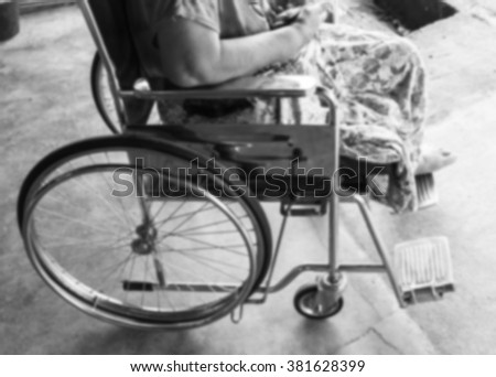 Closeup of elderly patient woman on wheelchair black and white.blur . - stock photo