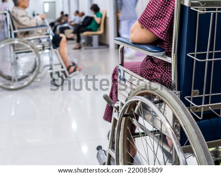 Closeup of elderly patient woman on wheelchair in hospital - stock photo