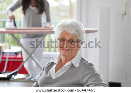Closeup of elderly woman with home help - stock photo