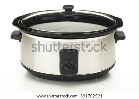 Closeup of electric crock pot on white background - stock photo