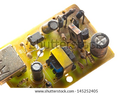 Closeup of electronic circuit board with burnt components - stock photo