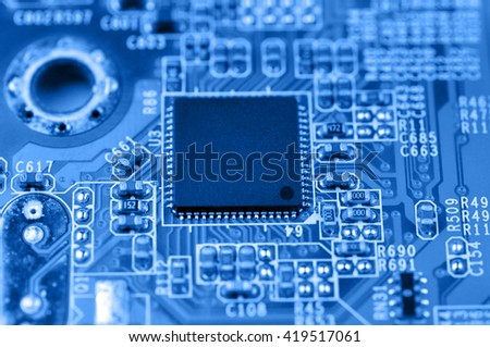 Closeup of electronic circuit board with chip. Macro with extremely shallow dof. - stock photo