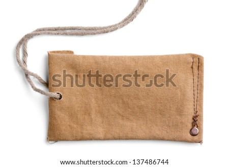 Closeup of empty cloth label with thread isolated on white background