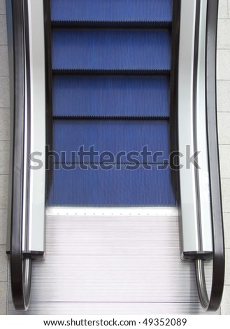 Closeup of empty escalator in shopping mall - stock photo
