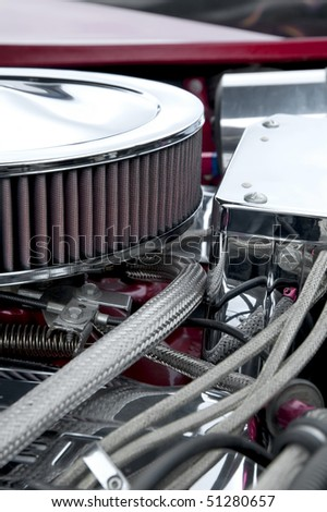 closeup of engine parts on a performance car