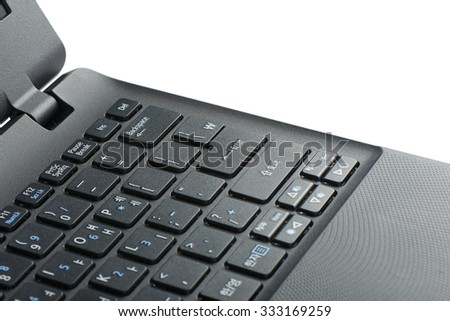 closeup of enter key on a laptop computer keypad, isolated on white - stock photo