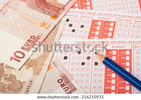 Closeup of Euro and sports betting slip  - stock photo