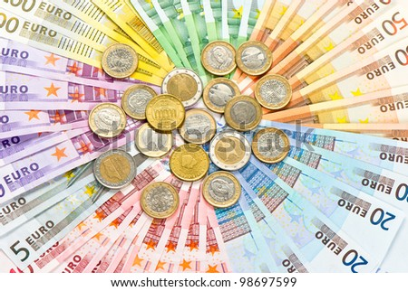 closeup of euro coins and banknotes. money background - stock photo