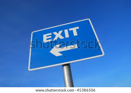 Closeup of Exit Sign against blue cloudless sky. - stock photo