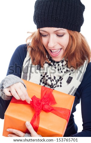 Closeup of exited winter woman opening present. - stock photo