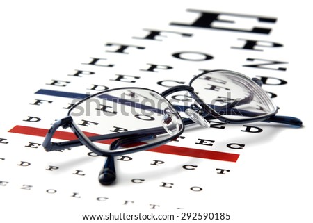Closeup of eyeglasses and test chart.Studio shot. - stock photo