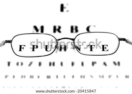 Closeup of Eyeglasses with an out of focus eye chart in the background