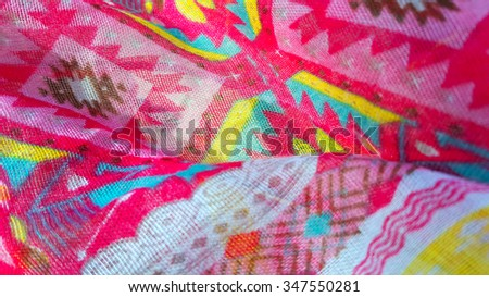 Closeup of fabric texture with bright colorful pattern  - stock photo