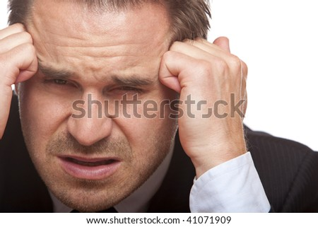 Closeup of face of businessman having heavy headache on white background.