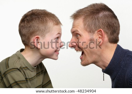 closeup of father and child making funny faces at each other - stock photo