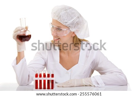 Closeup of Female Doctor or lab technician with Test Tubes of Red Liquid - stock photo