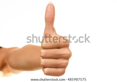 Closeup of female hand showing thumbs up sign against white background