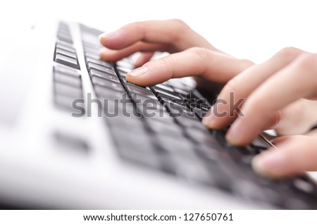 Closeup of female hands typing on keyboard. Shallow dof. - stock photo
