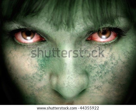 Closeup of female zombie face with bloodshot eyes and green skin - stock photo