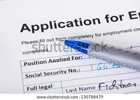 Closeup of filled application of employment and pen