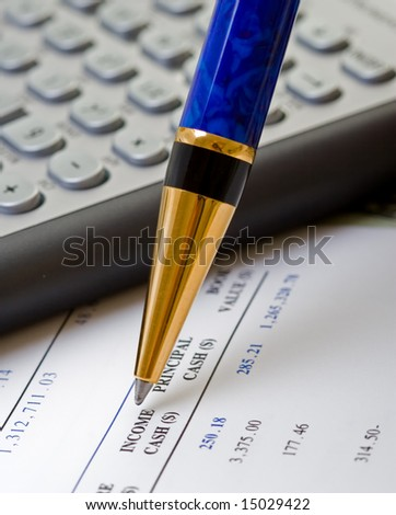 closeup of financial accounts pen diary and calculator - stock photo
