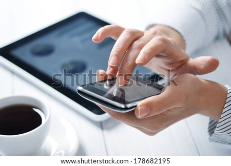 closeup of finger touching screen on smart phone with shallow depth of field - stock photo