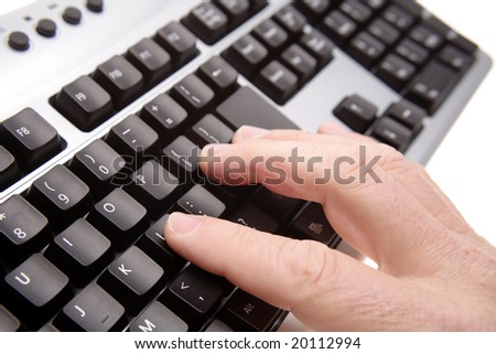 Closeup of fingers on computer keyboard