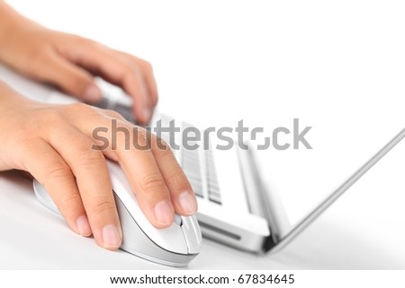 Closeup of fingers on computer mouse.