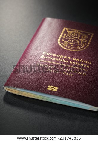 Closeup of Finnish (Finland) passport. This is the new (2013) design of the passport. - stock photo